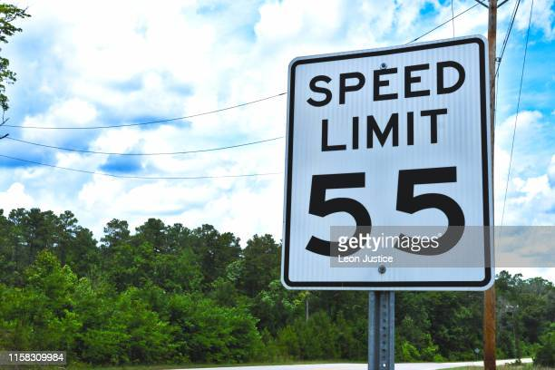 55 mph speed limit sign - speed limit sign stock photos and pictures
