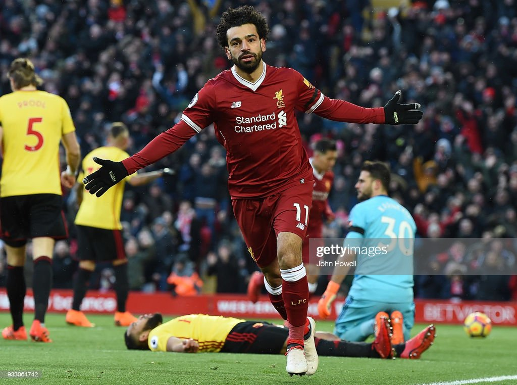 Mphamed Salah of Liverpool Celebrates the opening goal during the Premier League match between Liverpool and Watford at Anfield on March 17, 2018 in Liverpool, England.