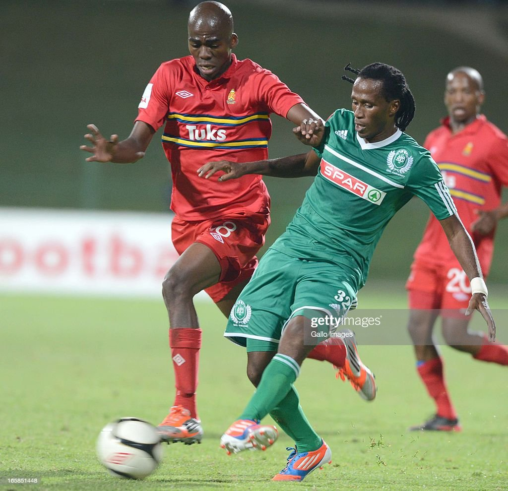Mpho Matsi and Tsweu Mokoro during the Absa Premiership match between University of Pretoria and AmaZulu at Tuks Stadium on April 06, 2013 in Pretoria, South Africa.