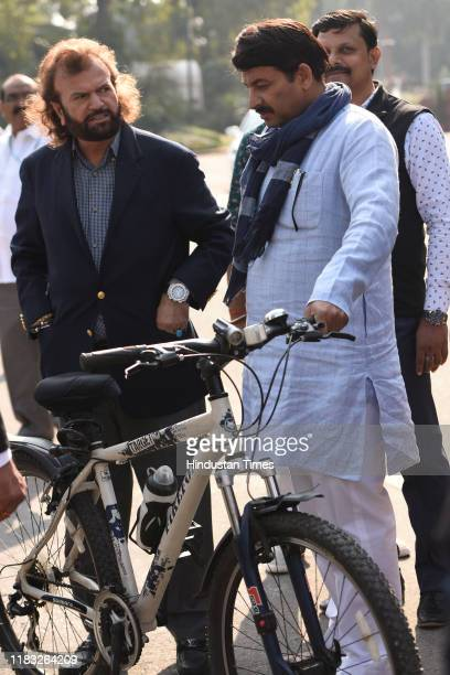 MPs Hansraj Hans and Manoj Tiwari during the first day of the winter session of Parliament on November 18 2019 in New Delhi India The 250th Rajya...