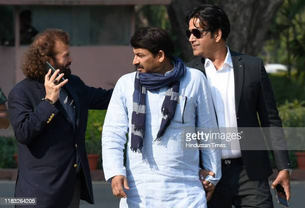 MPs Hansraj Hans Manoj Tiwari and Ravi Kishan during the first day of the winter session of Parliament on November 18 2019 in New Delhi India The...