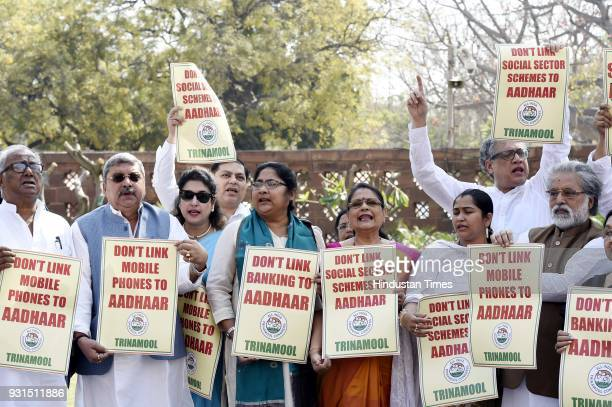 MPs hold placards against implementation of Aadhaar card during Budget Session at Parliament House on March 13 2018 in New Delhi India