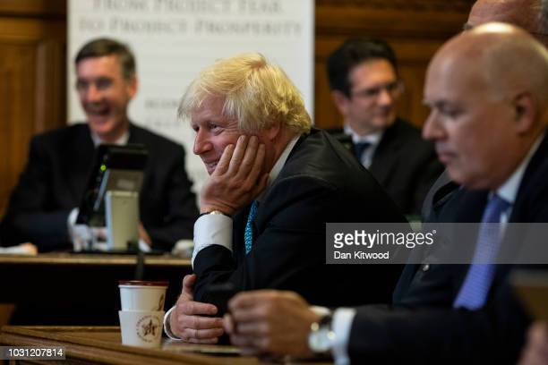 MPs Jacob Rees-Mogg, Boris Johnson and Iain Duncan Smith listen during the launch of 'A World Trade Deal: The Complete Guide' at the Houses of...