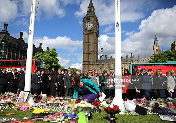 MPs lay floral tributes to Jo Cox in Parliament Square on June 20 2016 in London England Parliament was recalled from recess today so MPs could pay...