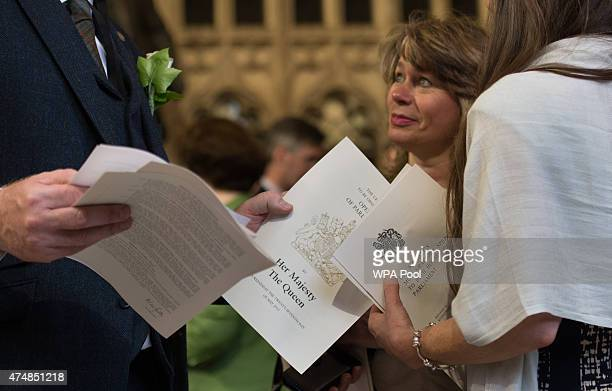 MPs look at the Queen's speech following the State Opening of Parliament in the House of Lords at the Palace of Westminster on May 27 2015 in London...