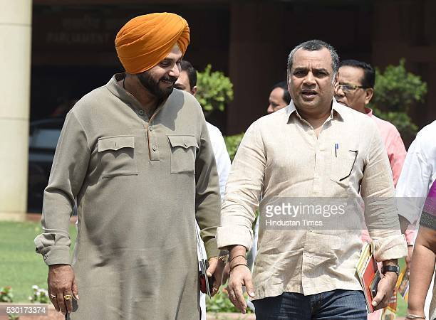 MPs Navjot Singh Sidhu and Paresh Rawal after the BJP Parliamentary Party meeting at Parliament House on May 10 2016 in New Delhi India The Lok Sabha...