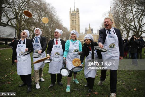 MPs Team practice flipping their pancakes as they take part in the 21st Parliamentary Pancake Race on Shrove Tuesday also known as Pancake Day or Fat...