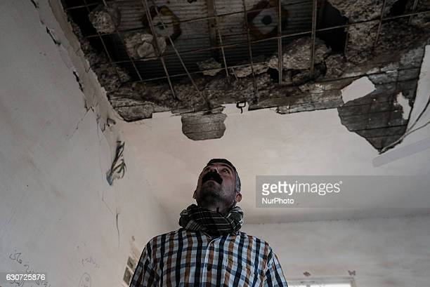 Mr Amar watching destroyed roof of his house in Tel Laban/ Gazakan on 30 December 2016 The Kakai Kurds are returning to their homes as Mosul...