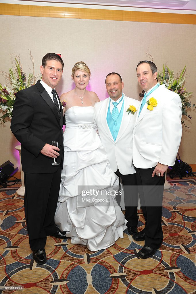 Mr. and Mrs. Aaron and Sabrina Greenwald pose with Mr. and Mr. Dennis and Joey Adisano-Sessa at a wedding for 11 couples at the Crowne Plaza Times Square on November 11, 2011 in New York City.