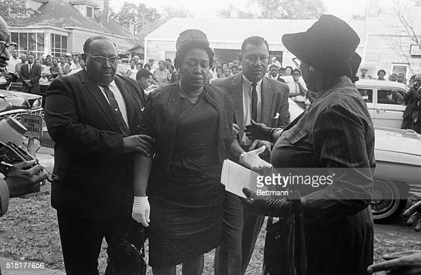 Mr and Mrs Alvin C Robertson arrive for funeral services for their 14yearold daughter Carol She was one of four victims of a bomb explosion in the...