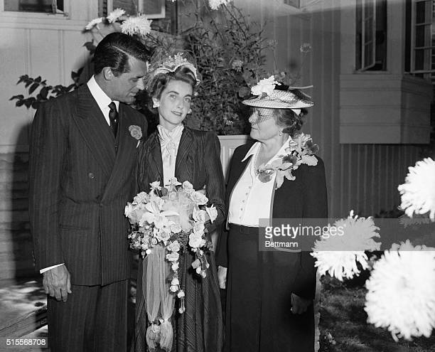Mr and Mrs Cary Grant pictured after their marriage with Mlle Tocquet the bride's companion since childhood