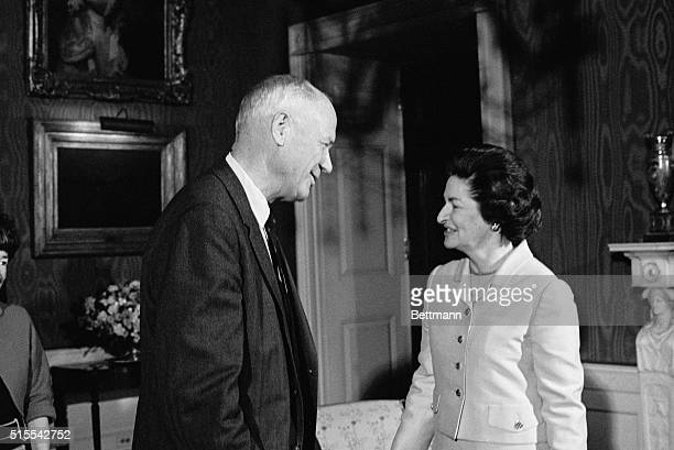 Mr. And Mrs. Charles A. Lindbergh of Darien, Conn., are shown being received by Mrs. Lyndon B. Johnson at a White House luncheon which she hosted for...