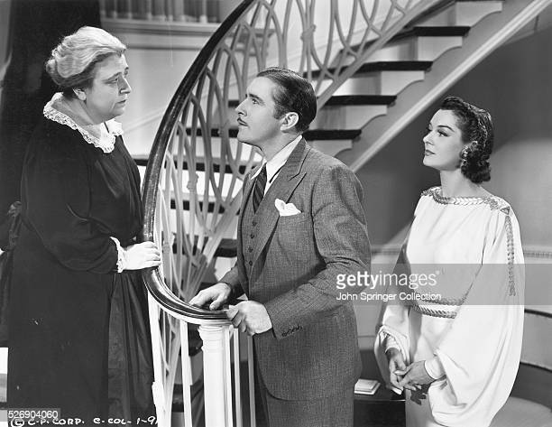 Mr and Mrs Craig speaking to their maid Mrs Harold in the film Craig's Wife