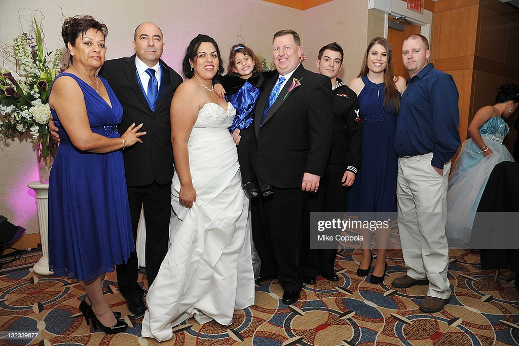 Mr. and Mrs. Dan and Myrna Wilkins (C) pose with guests at a wedding for 11 couples at the Crowne Plaza Times Square on November 11, 2011 in New York City.