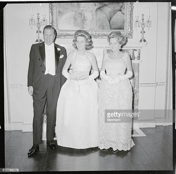 Mr and Mrs Henry Ford II proudly pose with daughter Anne at her debut ball at the Ford home 6/19 About 1100 guest were expected to attend the ball