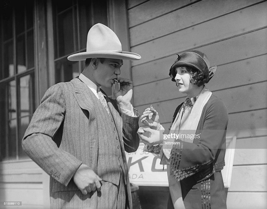 Jack Dempsey and Wife in Western Costume : News Photo