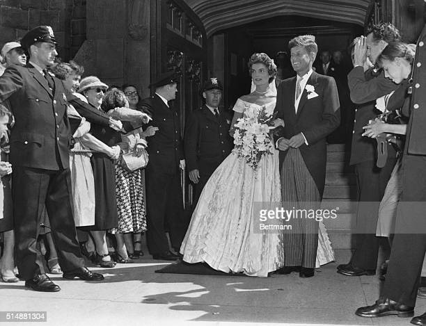 Mr and Mrs John F Kennedy and wedding party after church ceremony Photo