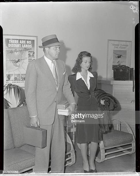 Mr and Mrs John Shipwreck Kelly step from a Pan American Airways' Anzac clipper from Honolulu after returning to the States from their month's...