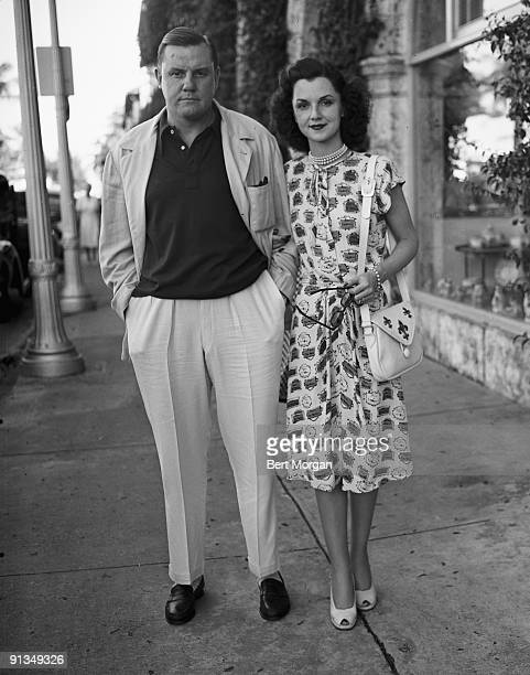 Mr and Mrs John Sims Kelly on sidewalk in Palm Beach Florida 1940s