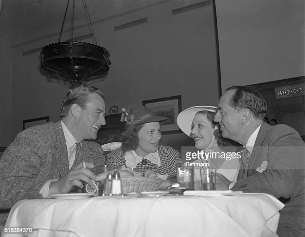 Mr and Mrs John Wayne Loretta Young and William Powell who is recuperating from a lengthy illness shown at the Beverly Hills Brown Derby before...
