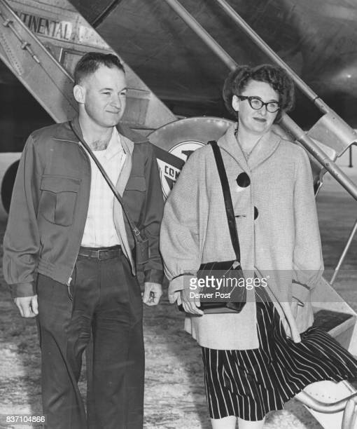 Mr and Mrs Leonard W Slater of Worland Wyo depart from a Continental Airlines plane at Denver after returning from 10 days of fishing at La Paz...
