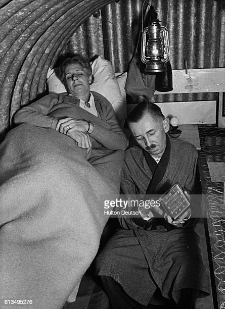 Mr and Mrs Murray bed down for the night in an Anderson air raid shelter