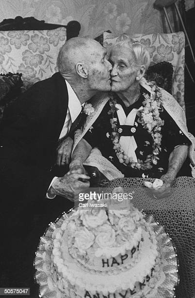 Mr and Mrs Peter Peterson kissing during their 80th wedding anniversary