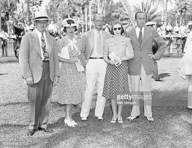 Mr and Mrs Russell Firestone Sr John C Clark and Mrs and Mr Leonard Firestone standing on a lawn at the ialeah Race Course Hialeah Florida 1942