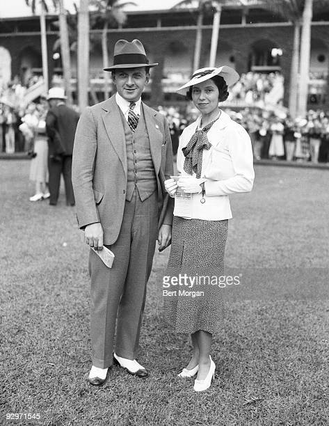 Mr and Mrs Russell Firestone standing on a lawn at the Hialeah Race Course Florida February 22 1937