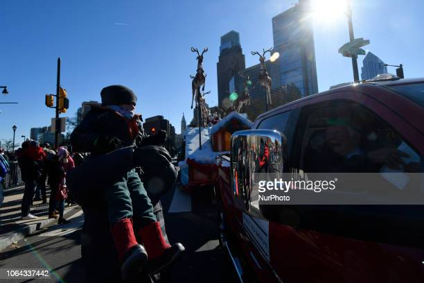 Mr and Mrs Santa are welcomed by thousands during the 99th 6ABC/Dunkin' Donuts Annual Thanksgiving Day parade in Philadelphia PA on November 22 2018...