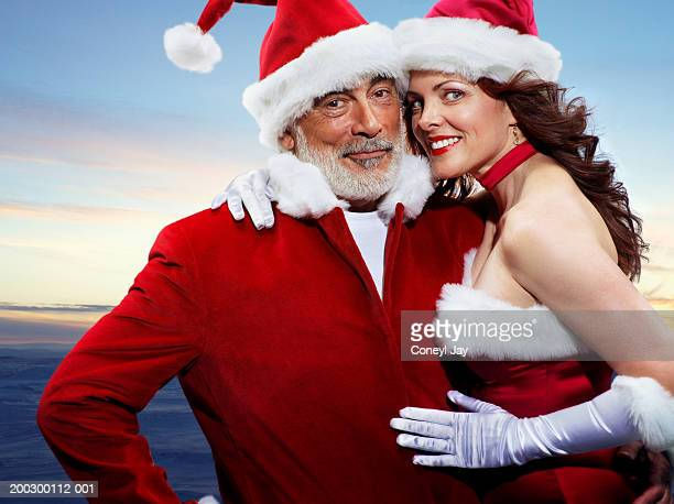 Mr And Mrs Santa Claus embracing, smiling, portrait
