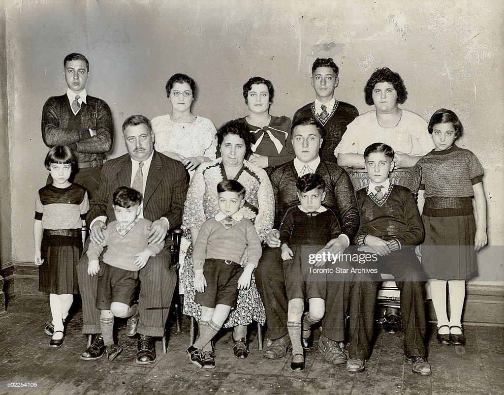 Mr. and Mrs. Steffano Darrigo of Toronto; and their family of 12. Mrs. Darrigo claims that she has h : News Photo