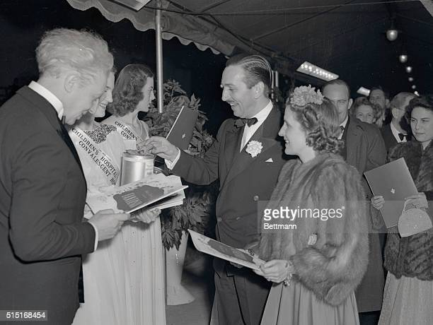 Mr and Mrs Walt Disney and Leopold Stowkowski arriving at the Carthay Circle Theater for the Hollywood premiere of Disney's Fantasia