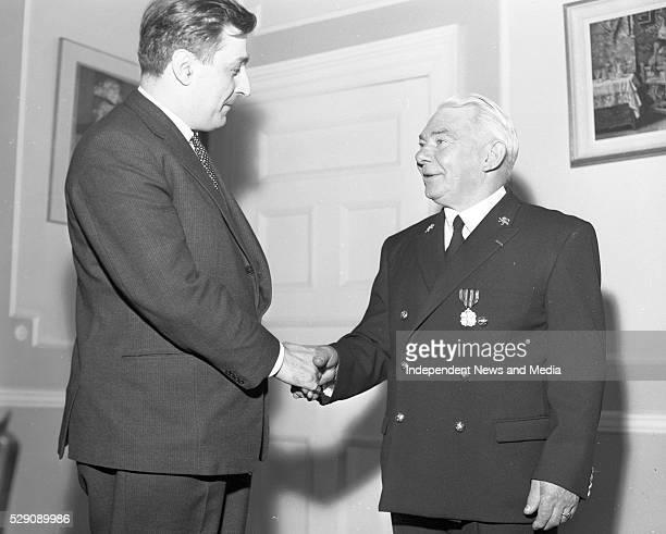 Mr Andre L de Vogelaere with Mr John Flood 29726