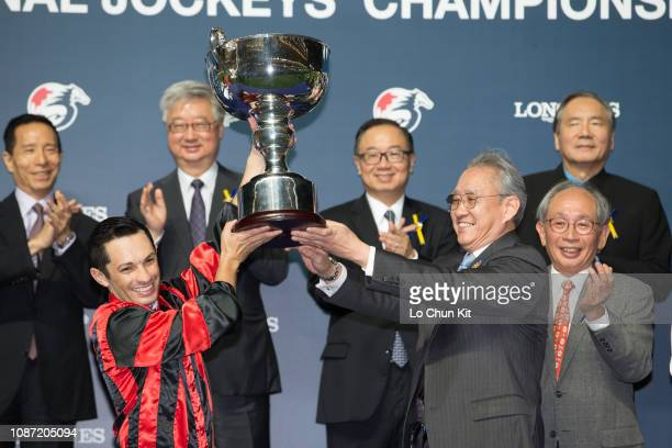 Mr Anthony Chow, Chairman of the HKJC, presents the trophy, a silver whip and cash prize of HK$500,000 to Silvestre de Sousa, winner of the LONGINES...