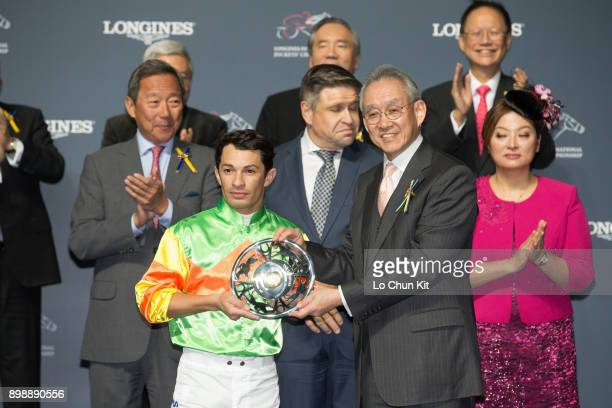 Mr Anthony W K Chow Deputy Chairman of the HKJC presents a silver dish to Silvestre de Sousa first runnerup of the LONGINES International Jockeys...