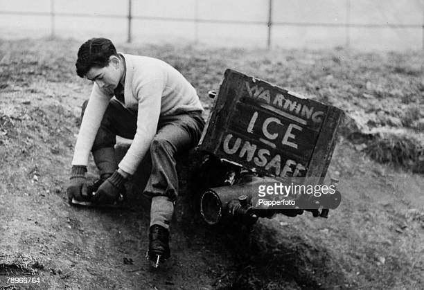 circa 1940's Northampton Northamptonshire England Skating at Abington Park lakes with Mr Arthur Marshman appearing to be ignoring the warning of...