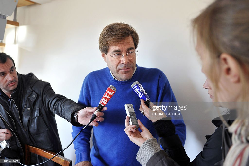 Mr Barnes, the father of a 12-year-old British boy, who disappeared on October 27 on the Porquerolles island answers to journalists' questions on October 29, 2012 as part of the search for his boy. Sixty soldiers and three civil security dog-handlers from Brignoles are paricipating in the search.