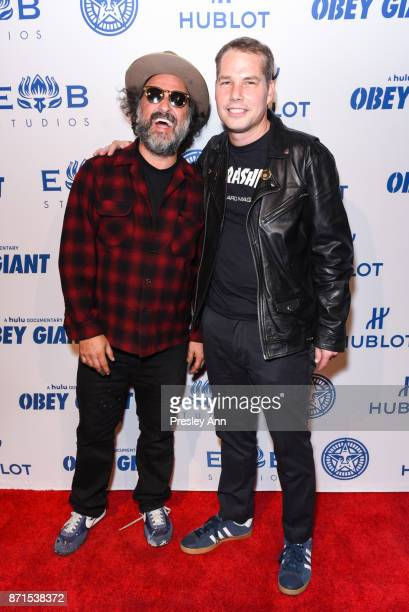Mr Brainwash and Shepard Fairey attend Photo Op For Hulu's Obey Giant at The Theatre at Ace Hotel on November 7 2017 in Los Angeles California
