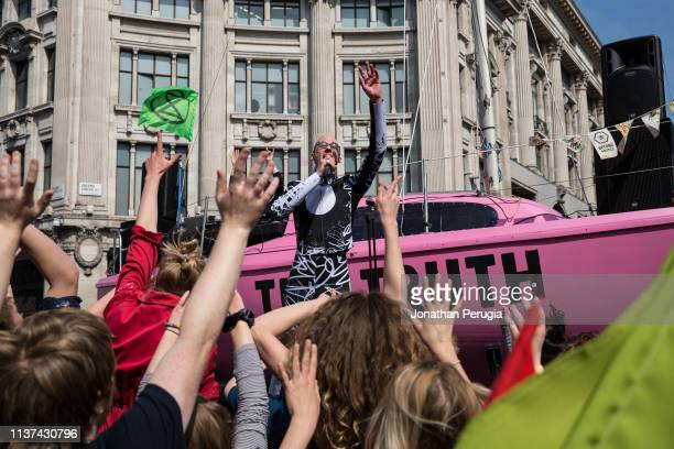 Mr Bruce from Electro duo The Correspondents dances on stage in front of a pink yacht during a protest against climate change in the middle of Oxford...