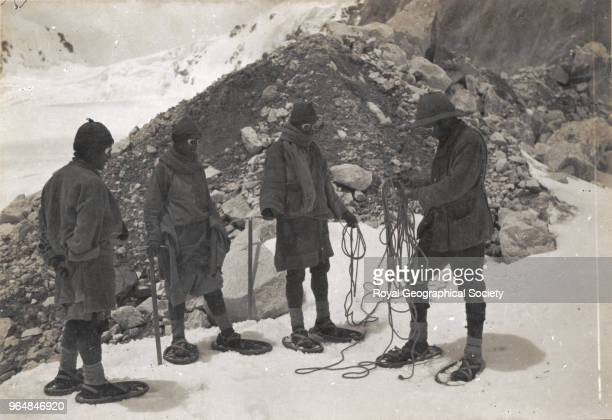 Mr Bullock and sherpas wearing snowshoes for the first time China 10th July 1921 Mount Everest Expedition 1921