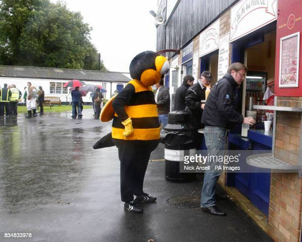 Mr Bumble the mascot for Barnet FC queues for a burger after the 10th annual Mascot Grand National at Huntingdon Racecourse Brampton Huntingdon...