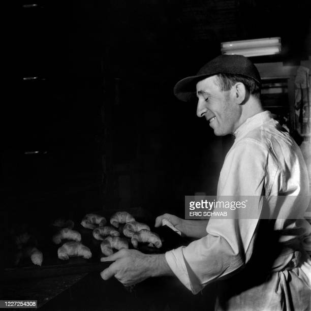 Mr Burel, owner of the French bakery Burel, prepares croissant, in New York, in the late 1940s.