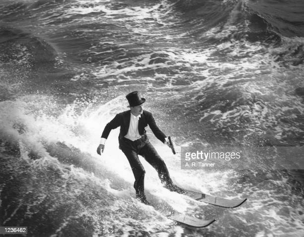 Mr C W H Andrew of London winning a 100-pound bet by water-skiing in a full top hat and tails outfit, off Seaview, Isle of Wight, 1st September 1938....