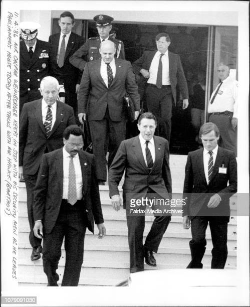 Mr Caspar Weinberger keeps in step with his security men as he leaves Parliament House today after takes with Mr Hawke April 11 1986