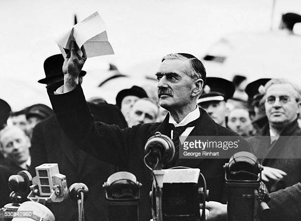 Mr Chamberlain is seen here speaking to a crowd on his arrival at Heston Airport from Munich where he had met Hitler Mussolini and Deladier to settle...