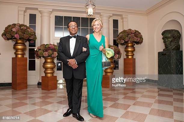Mr Clarence Page syndicated columnist and senior member of The Chicago Tribune editorial board and Ms Lisa Page arrive at the White House in...