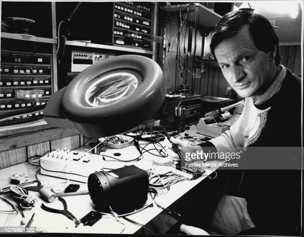 Mr Clive Freeburn from Yellow Light Car Alarm Company in his workshop with some finished products and in laboratory at Kurnell June 26 1987