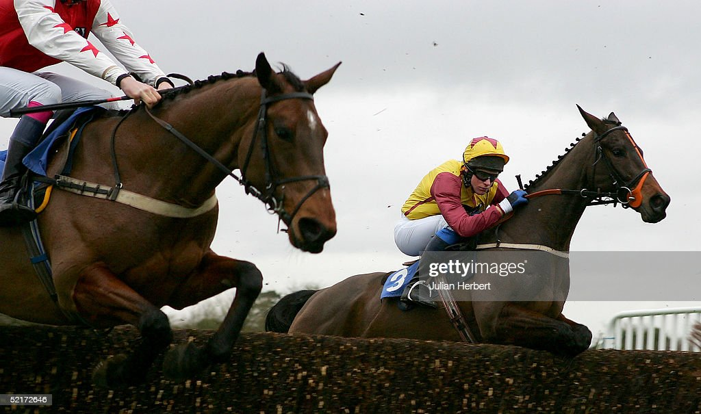 Mr Colman Sweeney aned Sleeping Night (R) lead Kingston-Banker over an early fence during The Stewart Tory Memorial Hunters Chase Race run at Wincanton Racecourse on February 10, 2005 in Wincanton, England. The 1-4 favorate fell at the 6TH fence.