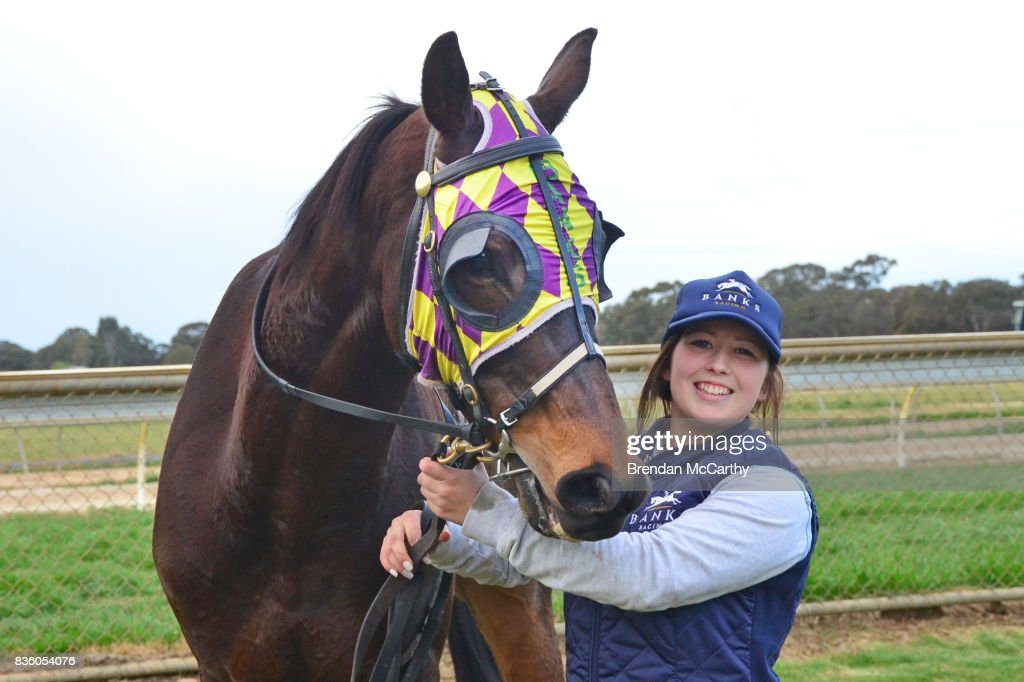 Mr Cooley and strapper Alex Patis after winning the Leveson Nth Melbourne BM58 Handicap at Echuca Racecourse on August 21, 2017 in Echuca, Australia.